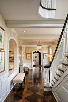 woodwork. Wood stairwell arches and bends beautiful entry foyer trim and millwork