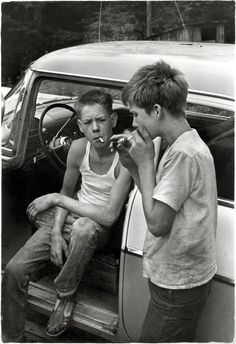 """Leatherwood, Kentucky, 1964. """"Cornett boys smoking by car."""" No after-school soccer for these lads."""