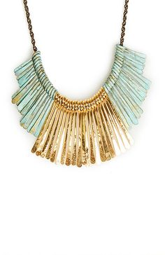 stamtement necklace in gold and turquoise