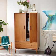 Our Mid-Century Wardrobe is crafted of FSC®-certified wood, adding modern-day sustainability to its classic 1950s and '60s design. The cabinet converts from hanging storage to shelving, perfect for any collection of shirts, slacks and dresses to pillows, blankets and sheets. It's an armoire that's amore.