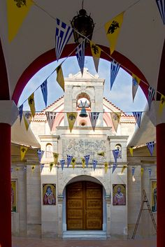 Greek and Byzantite Flags on the alley in Kalivia, Crete Island, Greece - Kriti, Grecia