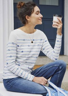 Our own playful take on the classic Breton stripe top - these pretty blue stripes are scattered with tiny colourful Kites. In soft, thick cotton with pretty button details at the shoulder and long sleeves.