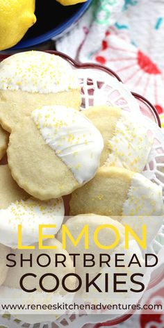 Buttery Lemon Shortbread Cookies by Renee's Kitchen Adventures. Lightly lemon flavored buttery cookies dipped in white chocolate and sprinkled with yellow sugar couldn't be prettier. #RKArecipes #lemoncookies #lemoncookierecipe #shortbreadcookies #Shortbreadcookierecipe Lemon Dessert Recipes, Easy No Bake Desserts, Easter Recipes, Baking Recipes, Cookie Recipes, Yummy Recipes, Bar Recipes, Lemon Recipes, Lemon Shortbread Cookies