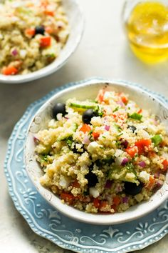 This quinoa Greek salad is earthy, briny, and all about the tang thanks to Feta and vinaigrette. It'll be great at your next big barbecue.