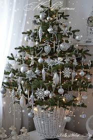 Beautiful Tabletop Christmas tree !. Small tree, white basket, silver and white ornaments, and a strand of clear Christmas lights ! Nelly Vintage Home