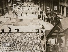 Workers lay bricks to pave 28th Street on October 2, 1930