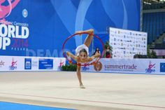 Sumire Kita (JPN) performing the hoop routine during the FIG Rhythmic Gymnastic World Cup series Pesaro 2014.