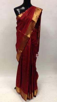 Maroon plain silk saree with classic self print and heavy golden Zari border & pallu. Elegant zari tissue pallu. 5.5 mts saree + 85 cms un-stitched blouse. lightweight Saree with golden zari border hi