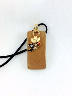 Elegant western girl domino pendant with hat, boots, and music charm hanging from a super soft black suede cord $25.00