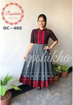DC - 462. Grey anarkali with red bodice combination and buttons pattern . The elbow length sleeves of the top have matching border to the dress. For queries kindly WhatsApp : +91 9059683293 20 January 2018