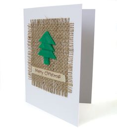 Here is a Christmas card that could easily become a place for a small Christmas x-stitch piece.