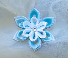 Our brooch was handmade with high quality satin fabric and attached with Swarovsky crystal.