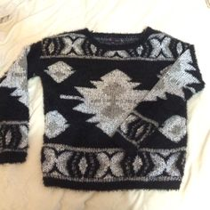 Black and white tribal print sweater Comfy black, white, and gray fuzzy sweater. Size small never worn. Sweaters