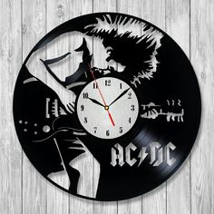 AC DC Amazing clock will become a unique decoration of any place.Exclusive wall clocks made from vinyl records will create the bright mood of your interior.