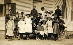 The students and teacher of the District 3 School in Oxford Township were photographed by commercial photographer E. H. Schlessman  in the 1910s.