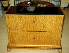 Artisan Furniture & Cabinetry     Contemporary chest in African satinwood with granite top.  3 drawers !