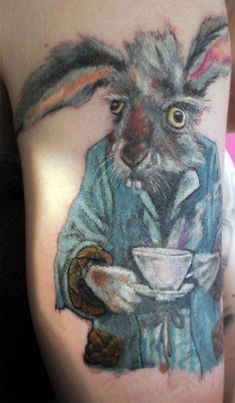 A funny tattoo design of the March Hare with a cuppa tea from Alice in Wonderland Tattoos Random Rabbit Tattoos, Leg Tattoos, Sleeve Tattoos, Trendy Tattoos, Cool Tattoos, Worst Tattoos, Alice And Wonderland Tattoos, Year Of The Rabbit, Eye Sketch
