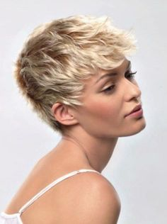 Dramatic and Edgy Messy Wavy Short Pixie Hairstyles 2014 with Top Accent