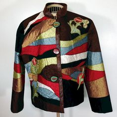 Patches of silk are perfectly positioned to create this artful, abstract, designer jacket.  Jacket is quilted to add texture and appliques.