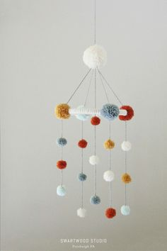 Baby Pom Mobile in Golden and Blues Medium by SwartwoodStudio