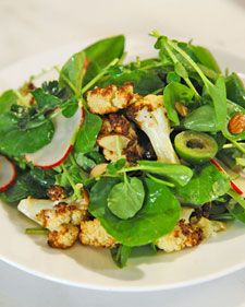Roasted cauliflower florets are the crunchy centerpiece of this salad, which is dressed with a sprightly vinaigrette.