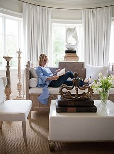 A beautiful neutral room, decorated with creams, whites and beiges, makes for a soothing place to read and relax, any time of the day!