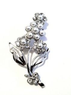 Gorgeous Crystal Faux Pearl Silvertone Bouquet Brooch Pin Sabz Jewelry. $2.99. brooch measure 2 1/2 inches long. designer inspired style. nickel and lead free. Gorgeous Crystal Faux Pearl Silvertone Bouquet Brooch Pin. faux pearl crystal accents. Save 90%!