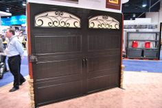 The Gallery collection of garage doors blends durability and aesthetic appeal. Unique Garage Doors, Black Garage Doors, Carriage House Garage Doors, House Doors, Garage Door Insulation, Iron Windows, Garage Makeover, Tuscan Decorating, Entry Doors