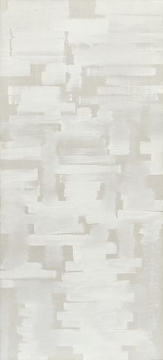 This painting is one of several monochromes in which Reinhardt explored the use of a vertical format. The combination of the white paint with the natural color of the underlying canvas emphasizes the composition.s tonal variations. The rough-edged, horizontal brushstrokes of varying length and paint saturation create a bricklike pattern that is at once structured and painterly. Reinhardt developed these brick forms with greater linearity and modularity in paintings such as Abstract Painting…