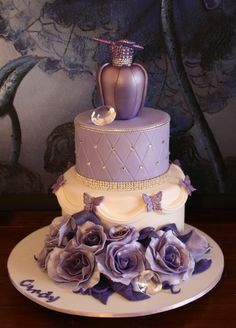 Change the bottle for a wedding topper n it would be beautiful.....Purple Perfume Heaven birthday cake