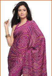 Magenta crush faux georgette bandhej printed saree. As shown blouse fabric can be made available and the same can be customized in your style or pattern; subject to fabric limitation, as the fabric is just drape on the model. (Slight variation in color is possible).