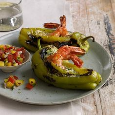 "Shrimp-Stuffed Peppers | Fruity, pale-yellow güero peppers—just like Hungarian wax peppers—are a great source of vitamin C, folate and manganese. They're perfect for stuffing because ""they have a little chile personality without being too hot,"" Deborah Schneider says. The shrimp-and-cheese filling here is a delicious source of protein."