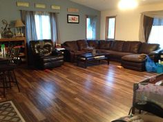 """Natural Acacia:  """"We took out the carpet in our living room and installed this. It made such a difference and I love the light/dark mixture of this flooring. We were random with the patterns of boards and it turned out great!"""""""