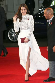 Kate Middleton in a Self Portrait gown. Follow the Duchess' lead and scoop up a lacy white confection of any length to pair with somber accessories and glossy hair this winter for equally glamorous results.