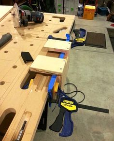 Recesses along one edge of the top can be used to hold screws, bits, and other…