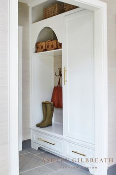 ASHLEY GILBREATH INTERIOR DESIGN: This mud room served as the perfect drop spot for the family's comings and goings. A built-in provided closet space, and drawers and shelves stacked with baskets allowed for ample storage to keep the space looking clean and organized. Ashley Gilbreath, Entry Closet, Building A New Home, Closet Space, Living Room Bedroom, Built Ins, Mudroom, Designing Women, Home And Family
