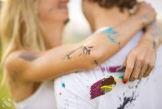 engagement photo session idea with white clothes and paint.