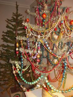 Feather tree with vintage glass garlands.