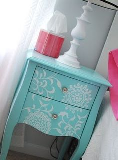 thinking about doing this to my current dresser....brown with white design or teal with white.   Have to wait till summer though to do it outside.