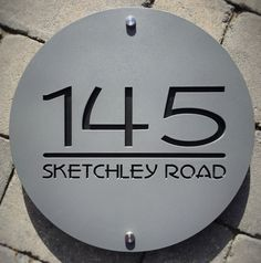 Just let me know house number, road name and two colours required when you place your order. Overview: Original Contemporary design. Matt Black, White and Grey colours available for outer. Laser cut Acrylic. Can be made with or without contrast background inside lettering. Other sizes available, all made to order. Details: Contemporary house sign/house number plaque. Laser cut acrylic finished in a range of colours to suit your home. Unique abstract designs available in various shapes. Si...