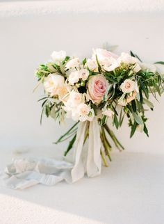 Stunning pale pink and white rose wedding bouquet: http://www.stylemepretty.com/destination-weddings/2015/11/07/ethereal-grecian-bridal-portrait-inspiration-in-athens/ | Photography: Vasia - http://www.vasia-weddings.com/
