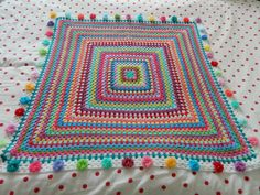 """Giant granny square w/flower edging. Also a tip to keep the granny """"square"""""""