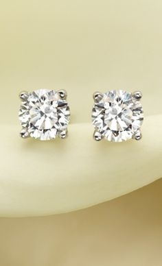 A beautifully matched pair of round diamonds secured in classic, four-prong basket settings with comfortable screw-back posts for pierced ears.