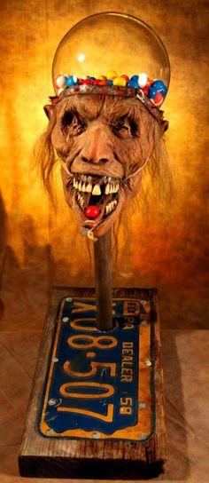 Scary zombie head gumball machine