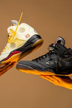 """The Air Jordan 5's 30-year anniversary saw Off-White and Jordan Brand come together on two colorways that update the model's original """"Fire Red"""" and """"Black Metallic"""" looks with die-cut perforations, vintage details, and other modifications."""