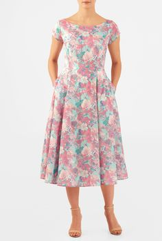Our fit-and-flare dress is cut from light cotton cambric dress in a washed floral print and topped with a boat neck and cap sleeves.