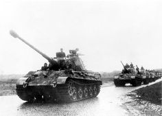 A column of Tigers II heavy tanks on the move Western Front 1944.