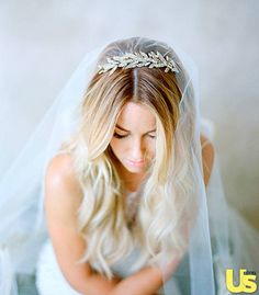 Lauren wasn't sure if she would wear the veil, but hairdresser Kristin Ess persuaded her.