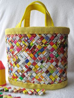 Don't throw out all those candy wrappers, especially now that candy prices are rising; get the most out of your raging sweet tooth by turning those wrappers into a handbag! Kika*de*colores made this bag out of 792 candy wrappers, along with paper from a phone book, yellow burlap, felt, and thread (here's a shot of the bag mid-construction). [via Craftzine]...