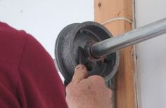 Never use screw drivers to unwind or wind garage door torsion springs.